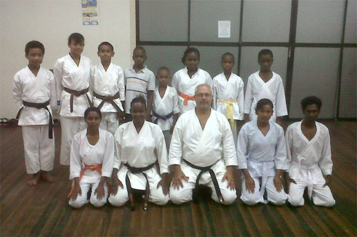 In the picture Amir Khouri, centre, kneeling and some of the karatekas.