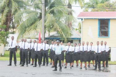Immaculate:  Part of the Passing Out Parade for five training courses yesterday  at the TSU Drill Square, Police Headquarters.
