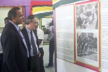 Minister of Culture, Youth and Sport Dr. Frank Anthony viewing the exhibits at the Independence Exhibition (Government Information Agency photo)