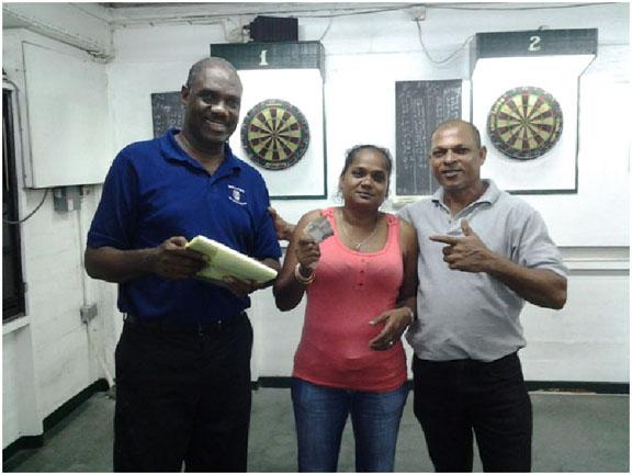 The winning pair Lallchand Rambharose and Jaswantie Hiralall with Bryan James (extreme left)