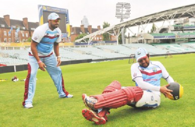 Ravi Rampaul and Ramnaresh Sarwan going through their exercise drills yesterday. (Photo courtesy of WICB media)