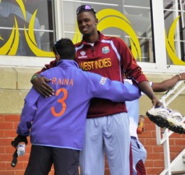 Should Jason Holder play today he certainly would not be so friendly with India's batting maestro Suresh Raina. (Photo courtesy of WICB media)