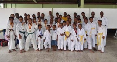 The students who participated in the championships pose with Sensei Winston Dunbar, Darren Nurse President of the Guyana Wado Ryu Karate Association and other officials.