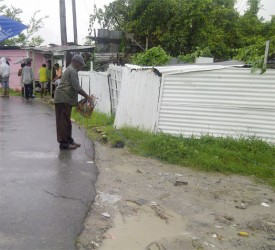 A GPL employee removing illegal connections after disconnecting them from an electricity pole in North Sophia. It is believed that Police Constable Dorwin Pitman who was chasing after a prisoner was electrocuted when he came into contact with illegal livewires.