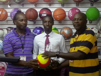 Giftland Public Relations Manager Compton Bobb (centre) flanked by Stabroek Warriors Sports Roy Ridley (left) and tournament coordinator O'neil Durant (right) at the Inter-Market Futsal competition launch