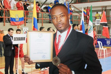 ANOTHER FIRST! Guyana's first World Championship boxing promoter Carwyn Holland shows off his SAMBO certificate.