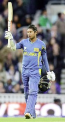 Sri Lanka's Kumar Sangakkara celebrates after reaching his century during the ICC Champions Trophy group A match against England at The Oval cricket ground in London yesterday. (REUTERS/Philip Brown)