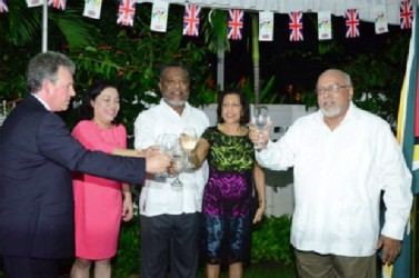 British High Commissioner Andrew Ayre (left) and President Donald Ramotar sharing a toast (GINA photo)