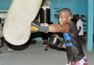 Laured 'Nightmare' Stewart going hard at the punching bag ahead of his June 29 ring date during his workout yesterday at the Forgotten Youth Foundation (FYF) gym yesterday. (Orlando Charles photo)