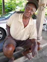 A village elder, Andrew McPherson, speaks on issues of land tenure in the village.