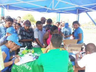 Residents at Annai flocked the tower site to get in on the great phone deals.