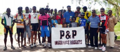 Winners and runners up pose with their respective prizes upon completion of yesterday's 13th annual P&P Insurance Brokers and Consultants Limited 11-race cycle programme.