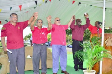 President Donald Ramotar (third from left) with (from left)  Minister of Labour Dr. Nanda Gopaul,  GAWU President Komal Chand, President of the Federation of Independent Trade Unions of Guyana,  Carvil Duncan and FITUG's General Secretary Kenneth Joseph during the singing of 'The Internationale'. (GINA photo)