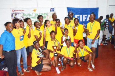 Tutorial High School after winning the Scotiabank/Pepsi Schools Football National Championship title yesterday evening at the Ministry of Education ground, Carifesta Avenue.