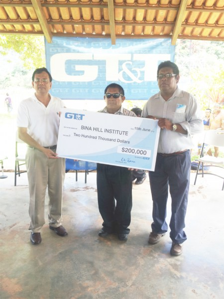 GT&T yesterday donated $200,000 to the Bina Hill institute in North Rupununi to assist with the development and sustainment of the institute.  From left: GT&T CEO R K Sharma , Chairman of the NRDDB Michael Williams and CEO of NRDDB Ivor Marslow hold up the cheque.