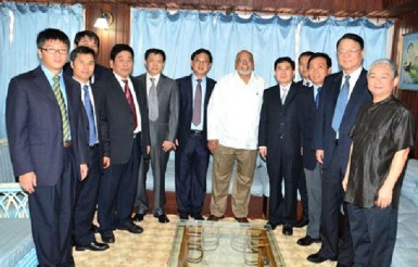 President Donald Ramotar (centre) with a delegation from China Chengtong Holdings Group Limited. Chinese Ambassador to Guyana Zhang Limin (right) accompanied the group. (GINA photo)
