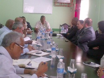 Labour Minister Nanda Gopaul at head of table, meeting with representatives of the Georgetown Chamber.