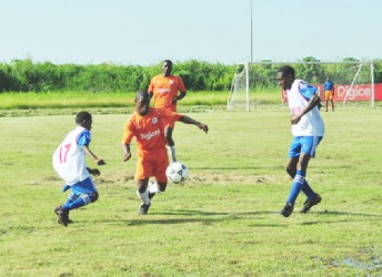Tevin Garraway takes possession of the ball during the match with St. John's College in the Digicel's Schools Football Championship, yesterday afternoon at the Ministry of Education Ground, Carifesta Avenue (Orlando Charles photo.)