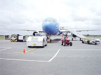 A plane on the ground at the Cheddi Jagan International Airport, Timehri (Stabroek News file photo)