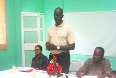 UNDP official Trevor Benn addressing residents of Region Seven at the session on human trafficking (GINA photo)