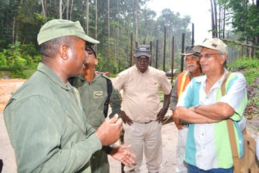 A GDF pilot (left) in conversation with the visiting team. At right is APNU MP Dr Rupert Roopnaraine. At centre is Minister of Works, Robeson Benn. (GINA photo)