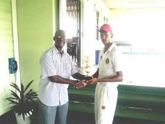 Derek Narine receives his man of the match trophy from Chairman of the GCB Competitions Committee, Colin Europe.
