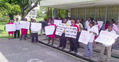 Picketers congregate at the admissions building after the march around campus