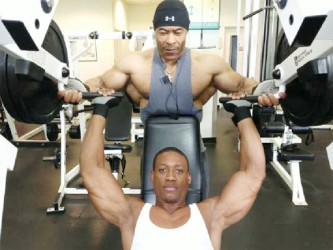 Kerwin 'Chisel' Clarke in training with Guyanese world renowned bodybuilder, Hugh Ross at the Brooklyn Sports Club last week.