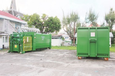 White elephants: The two compactor sections of the trucks that were donated by the Ministry of Local Government to City Hall last month (Photo by Arian Browne)