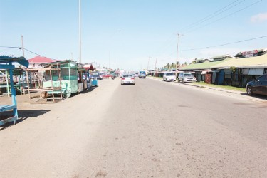 On the right are some of the Mon Repos Market stalls that have to be removed to facilitate the extension of the East Coast four-lane road. (Photo by Arian Browne)