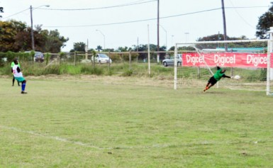 A Carmel Secondary School player scores from the penalty spot.