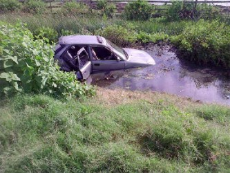 The car in a trench after the accident