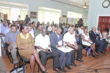 Stakeholders listen to the significance of the Basic Needs Trust Fund's seventh project cycle during its launch yesterday (Photo by Arian Browne)