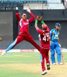 OVERJOYED!West Indies spinner Sunil Narine and captain Dwayne Bravo celebrate the wicket of Mahela Jayawardene. WICB Media Photo
