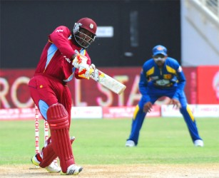 West Indies opener Chris Gayle hits a massive six during his innings of 109 as West Indies beat Sri Lanka by 6 wickets to win Match 1 of the CELKON Mobile Cup ODI tournament at Sabina Park  yesterday. WICB Media Photo