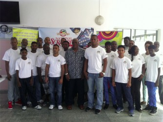 The players along with the President of Guyana Association of Scrabble Players (GASP) Leon Belony, Administrative Officer of the NSC Gervy C. Harry, Courts Marketing Manager Pernell Cummings after the opening ceremony yesterday morning at Bank of Guyana.