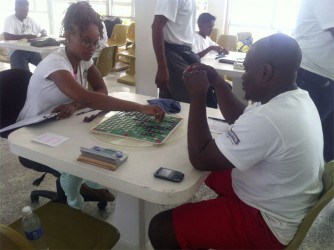 Robert Williams (right) and Abigail McDonald in the first round of the National Scrabble Championship yesterday morning.