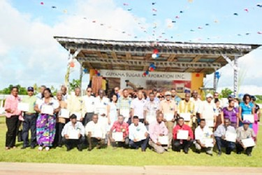 Minister of Agriculture, Dr. Leslie Ramsammy, GuySuCo officials and the workers pose in this GINA photo.
