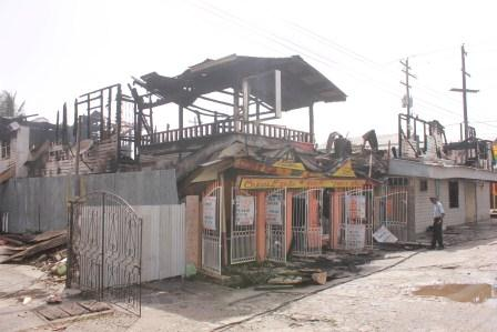 The fire-ravaged buildings.