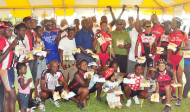 Winners and runners up pose with their respective prizes upon completion of yesterday's 10 annual Caricom Day Wheat-Up Cycling Classic. (Orlando Charles photo)