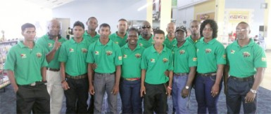 Going For Gold! Guyana's contingent of powerlifters strike a pose at the Piarco International Airport ahead of their international duty in Orlando, Florida.