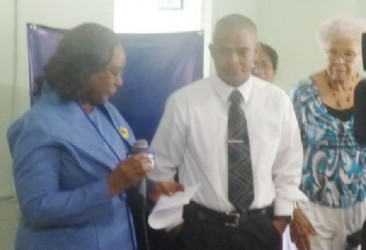 President Sherlock Reece (centre) and officials of the Foundation at the handing over ceremony