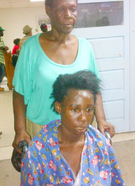 Irene Barry wheels her visibly shaken daughter out of the Accident and Emergency Unit of the Georgetown Public Hospital