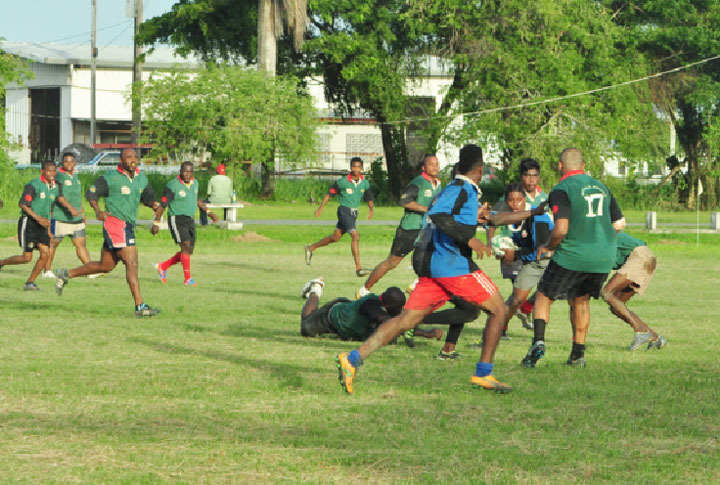 The National under-19 ruggers going against the rest team made up of national senior players  during yesterday's final simulation game at the National Park rugby field. (Orlando Charles photo)