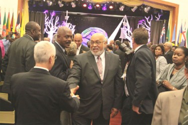 President Donald Ramotar  (centre) greeting an invitee at the Opening Ceremony of the Heads of Caricom Summit in Trinidad and Tobago on Wednesday. (Neilon A Dias photo)
