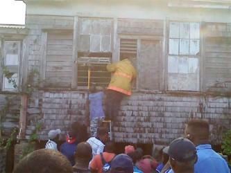 A fireman entering the home of Jacquelin Soares