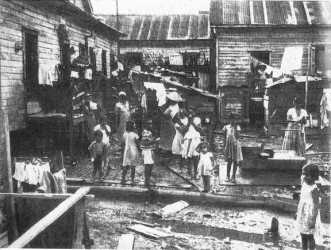 A tenement yard in the 1950s (from 'British Guiana: Land of Six Peoples' by Michael Swan, 1957)