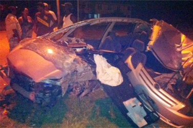 The badly mangled car