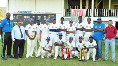 "From left are: Coach Quason Nedd, GCB President Dru Bahadur, the winning Demerara U19 team, Manager Robert ""Pacer"" Adonis and GCB secretary  Anand Sanasie."