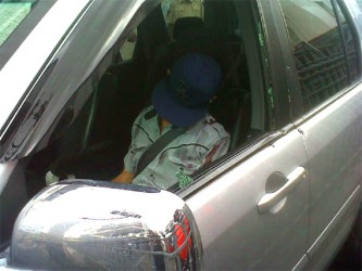 Victor Da Silva slumped in the front passenger seat of the car after he was shot dead by bandits  yesterday morning